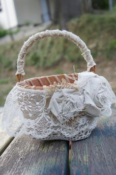 Vintage flower girl baskets - Kinda Boho in this pic but it can be more elegant... real flowers on the basket, too!