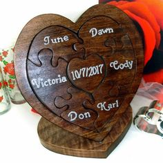 Here's a simple but elegant unity ceremony wedding puzzle for a bride and groom it has pieces for each of their parents as well it features a heart should puzzle stand and has a special quote hiding inside the puzzle tray  like a surprise