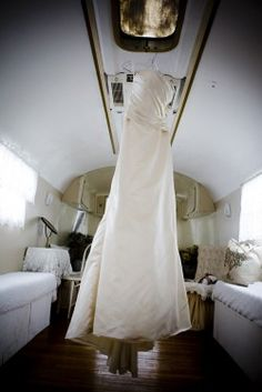 wedding dress inside an Airstream. Love it. www.MadamPaloozaEmporium.com www.facebook.com/MadamPalooza