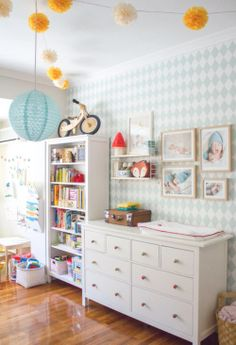Teal and white harlequin wallpaper in kids room