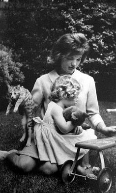 Jackie and Caroline Kennedy with cats at Hyannis Port, Massachusetts in the summer of 1961.
