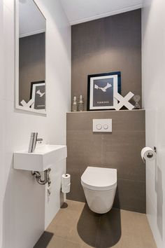 a neutral guest toilet done in taupe and white, an artwork, a wall mounted sink and a large mirror Small Downstairs Toilet, Small Toilet Room, Guest Toilet, Downstairs Bathroom, Bathroom Closet, Bathroom Toilets, Bathroom Wall, New Toilet, Family Bathroom