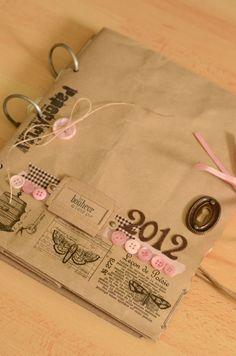 A paper bag mini album scrapbook.