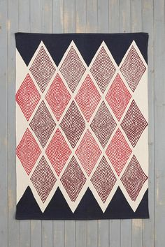 Kerala diamond woven cotton rug from Magical Thinking. #urbanoutfitters