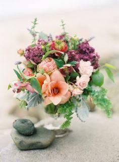 Peach and lilac floral centerpiece | http://burnettsboards.com/2014/01/romantic-summer-garden-wedding/