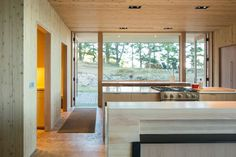modern wooden kitchen interior with open space and wooden ceiling and walls