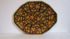 Daher Decorated Ware extra large tin serving tray measures 17.5 x 13 , is 12-sided and features lotus blossoms. In colors of orange, yellow and green on a brown background. Has an almost rainbow like inner and outer decorative moroccan style border. Very good condition. Has a few surface scratches. .  Shipping costs are estimates based on shipping from Wisconsin to California. States closer to Wisconsin will be cheaper. I will refund any shipping overages that are over $2. Package will be…