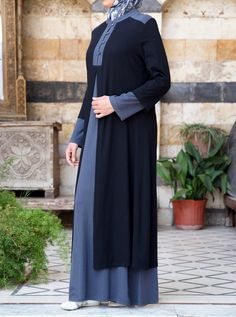 Love layering, but hate the bulk? Our Double Layer Jersey Abaya fits the bill. Crafted in our lightest-weight jersey, this abaya is as easy to wear as it is to care for. The faux layers add light texture, while the contrasting color-blocking creates a fun and contemporary look.