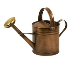 """Tauba Small Copper Watering Can - Antique look, water tight, copper pitcher features ribbed detail with top and side handles. Material: 95% zinc galvanized iron sheet, 5% brass. 8""""h x 17""""w x 12""""."""