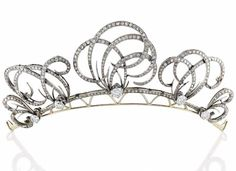 DIAMOND TIARA. Adorned with five scroll, set with diamonds, gold setting, total…