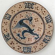 Plate Date: 1425–1450 Geography: Made in probably Manises, Valencia, Spain Culture: Spanish Medium: Tin-glazed earthenware Dimensions: Overall: 1 15/16 x 14 11/16 in. (5 x 37.3 cm)