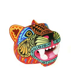 Fantastic jaguar mask by Luis Pablo. Luis Pablo is one of the top Oaxacan wood carving masters. Luis Pablo is one of the very few that work alone…he doesn't have a workshop with apprentices that help paint, sand or carve his pieces.