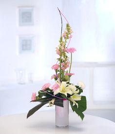 Flower arrangement in pink and cream. A feminine modern display.