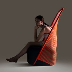 Cradle chair by Benjamin Hubert's Layer for Italian furniture brand Moroso, featuring a stretch-mesh material made using new digital knitting techniques #furniture #design