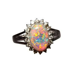 Absolutely stunning Semi Black Opal ring for any time wear or for those looking for a Black Opal engagement ring.