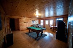 Game room at the bottom level of the Lake House.  Broken Bow Cabins.