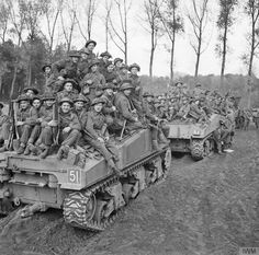 Infantry of 51st Highland Division are carried into battle aboard Sherman tanks near Udenhout, 29 October 1944. photos courtesy of http://www.iwm.org.uk/