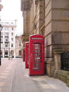 Red telephone box in Birmingham, England.