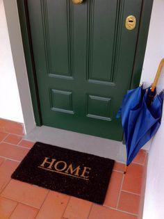 My home. A green door.