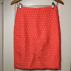 Bright melon 00 J. Crew pencil skirt J. Crew bright melon pencil skirt with polka dots! Perfect for spring and summer! Fully lined, invisible back zip, hook and eye closure. Beautiful condition! No issues! (No trades please.) J. Crew Skirts Pencil