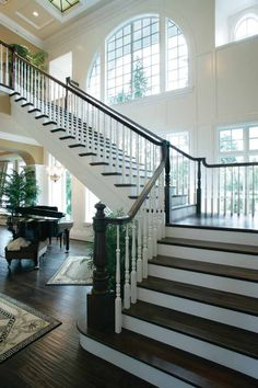 i love so much about this...wall of windows, wide staircase, stairs out of the way, and the baby grand tucked underneath