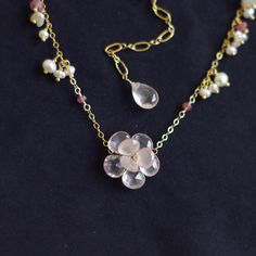 Floral necklace with rose quartz by FridaHandmadeJewelry on Etsy
