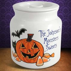 Personalized Halloween Cookie Jars. Holds a Cauldron of Cookies! Break out the Halloween Cookies and put them in this whimsical cookie jar. This jar has a gigantic capacity of over one gallon of your favorite spooky treats. Dress up your home for Halloween with this unique air tight jar.