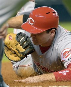 Cincinnati Reds' Joey Votto is ... out. Well, that was anticlimactic. Even for a still photo.
