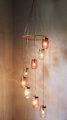 I really want to make a Mason Jar Chandelier Hanging Light Fixture like this with the spiral waterfall effect but use as a wine bottle chandelier.