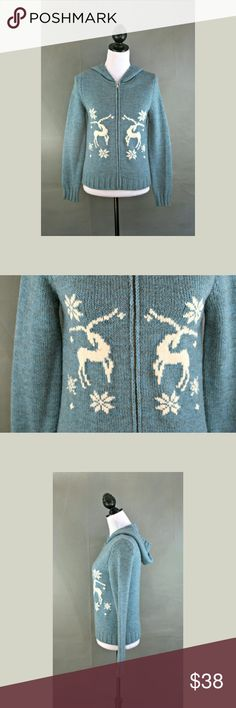 """Benetton reindeer zip sweater Approximate measurements Top of shoulder to hem: ~23"""" Bust laying flat: ~17"""" Waist laying flat: ~17""""  Nice light blue reindeer zip sweater from Benetton. Size medium. United Colors Of Benetton Sweaters Cardigans"""