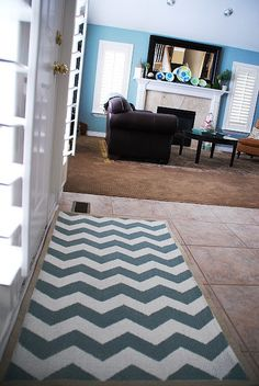 This tutorial to make a painted chevron doormat/rug is a real hit with the trendy and thrifty homeowner. doormat.  chevron.  DIY rug.