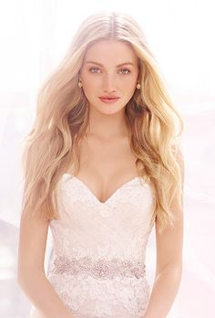 Brides: Ti Adora by Alvina Valenta. Ivory / champagne romantically layered modified a-line bridal gown with a glamorous embroidered trim at the natural waist. Strapless sweetheart neckline with a draped English net overlay and hand placed re-embroidered lace throughout.