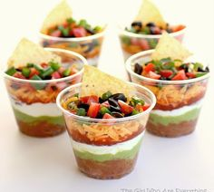 Layered Mexican Dip cups for the next potluck I attend