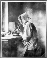 Sister Frieda Wetzel working with a microscope, Tanzania, ca.1927-1938 :: International Mission Photography Archive, ca.1860-ca.1960    #Microscope #Tanzania #Sister