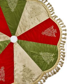 """Jeweled Tree Christmas Tree Skirt   Balsam Hill-designed with luxuriant velvet, embroidered Christmas tree designs,faux crystal accents,& decorative tassel trim. On Sale for $89 was $159.60"""" in diameter- Looks like faux crystal accents of different colors for each embroidered tree i.e. green faux crystals on tree that's on green material, red crystals on red material, & so on."""
