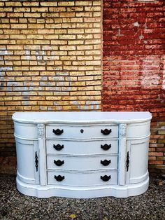 Professionally painted buffet in white. Modernized, vintage, refinished furniture from Carver Junk Company. http://www.carverjunkcompany.com