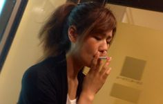 Sweet Japanese girl smoking 54