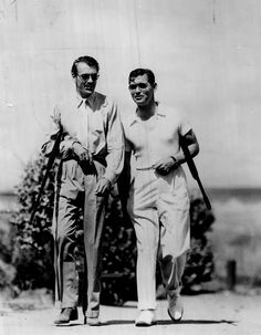 A-HUNTIN' WE WILL GO.  Gary Cooper & Clark Gable with shotguns under their arms.