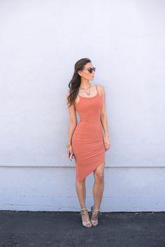 Komono sunglasses, pamela love necklace, and body conscious asymmetric dress