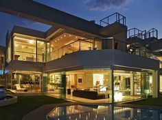 Glasshouse is a spectacular house located in Johannesburg, South Africa designed by Nico Van Der Meulen Architects.