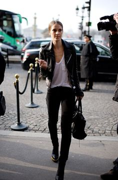 Slouchy white tee, leather jacket.