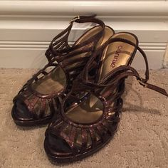 Dark Bronze Strappy Heels These beautiful strappy heels are looking for a new home! The beautiful bronze color compliments almost any color and is easy to pair with. Has only been worn once indoors. The heel is about 3.5 inches Shoes Heels