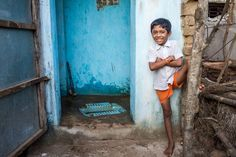 THAT'S MY TOILET!   ---   Gajanan Narahari Hemane, 6, poses outside his residential toilet in Chandrapur District, Nagpur.     Did you know that the economic gains from investing in sanitation and water are estimated to be 170 billion dollars per year?    ©UNICEF/2012/Dhiraj Singh