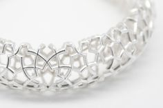 Kevin Wei's 3D printed silver jewelry.Join the 3D Printing Conversation: http://www.fuelyourproductdesign.com/