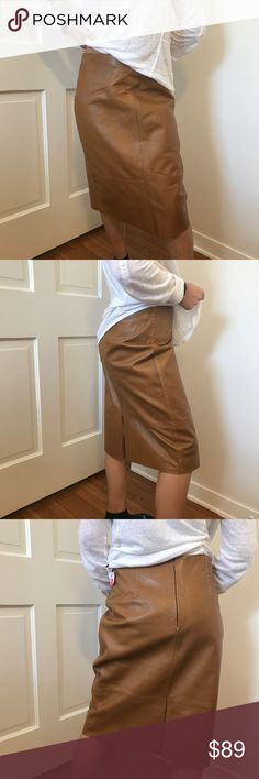 Banana Republic tan leather skirt Banana republic 100% leather skirt. I'm 5' and goes to my shins, will look good if your taller than me. Brand new with original tag. Has stitchings running vertically which makes this skirt look extra cute. Make an offer if interested. Banana Republic Skirts Midi