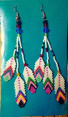 Tribal feather earrings by AlaskaBunnyBeading on Etsy https://www.etsy.com/listing/237873261/tribal-feather-earrings