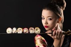 beautiful girl samurai with sword and rolls