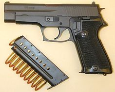 Early SIG-Sauer P220 pistol in 9mm. It is same as Swiss service Pistole 75, and has a bottom magazine release.