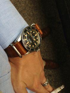 vintage Rolex on leather NATO strap