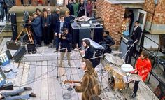 Filming of The Beatles' final public performance, on the roof of the Apple offices. ""